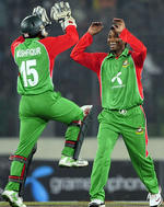 Mushfiqur Rahim and Alok Kapali celebrate another wicket