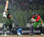 Umar Akmal is stumped by Mushfiqur Rahim