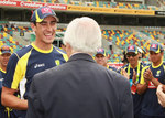 Richie Benaud presents Mitchell Starc with his baggy green