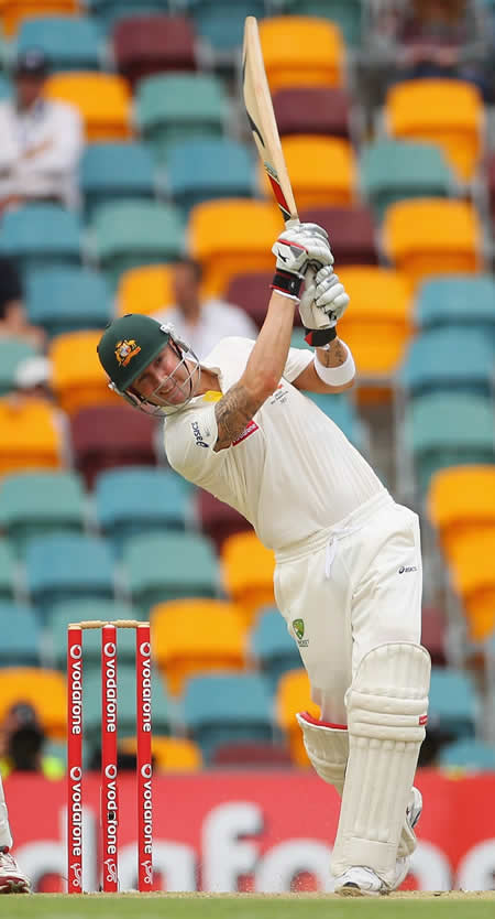 Michael Clarke drives down the ground