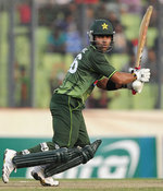 Umar Akmal plays one to the off side