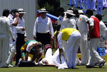 Jacques Kallis receives treatment after being struck on the head
