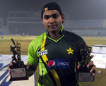 Umar Akmal with the Man of the Match and Man of the Series trophies
