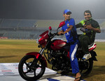 Nasir Hossain gives Umar Akmal a ride on the bike he won as Bangladesh's best player of the series
