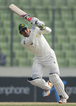 Adnan Akmal whips the ball to the leg side