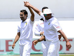 Imran Tahir celebrates after getting a wicket off a knee-high full toss down the leg side