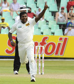 Rangana Herath celebrates the wicket of Ashwell Prince