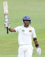 Dinesh Chandimal celebrates his second half-century of the match