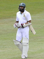 Hashim Amla walks back after being run out