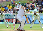 Graeme Smith chops Dhammika Prasad back onto his stumps