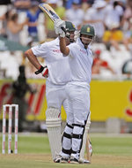 Alviro Petersen raises his bat on reaching his half-century