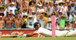 Ricky Ponting dives in to his crease to complete his century