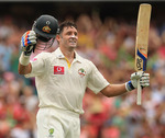 Michael Hussey acknowledges the applause after his century