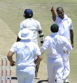 Vernon Philander shows Rangana Herath the way to the dressing room