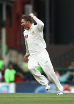 Michael Clarke is ecstatic after snagging Sachin Tendulkar
