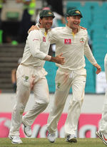 Ricky Ponting and Michael Clarke celebrate winning the New Year's Test