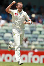 Peter Siddle celebrates the dismissal of MS Dhoni