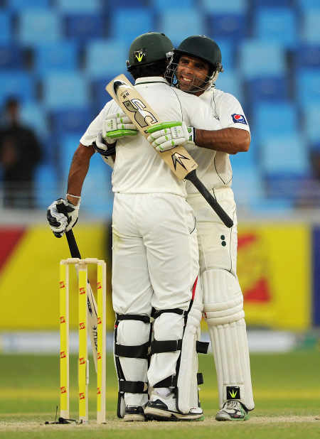 Taufeeq Umar and Mohammad Hafeez embrace after knocking off the 15-run target