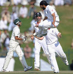 Monty Panesar leaps after bowling Younis Khan