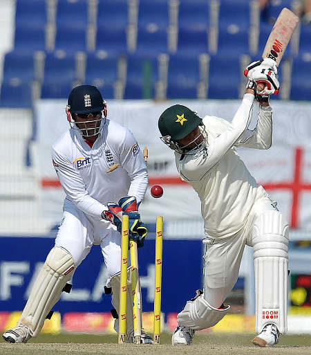 Junaid Khan swings and is bowled by Monty Panesar
