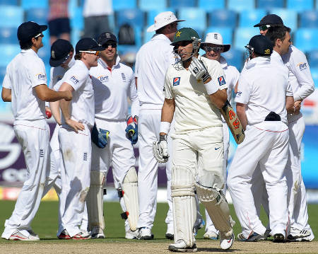 Misbah-ul-Haq walks back after being trapped by James Anderson