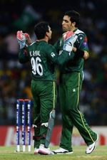 Umar Gul and Kamran Akmal celebrate
