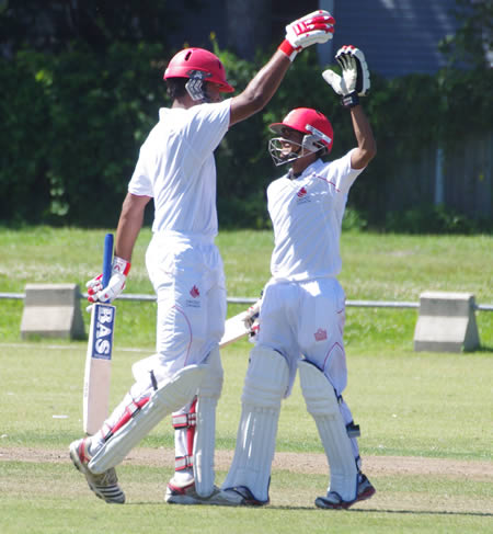 High fives exchanged as Ruvindu Gunasekera (left) celebrates his century with Salman Nazar
