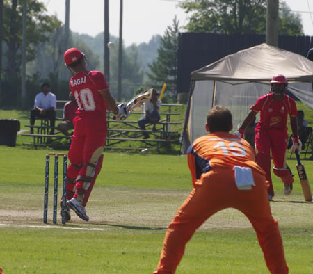 The last ball of Timm van der Gugten's (not in picture) first over rises steeply past Canadian captain Ashish Bagai