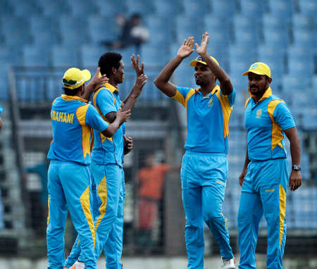 Al Amin (2nd from L) celebrating a wicket