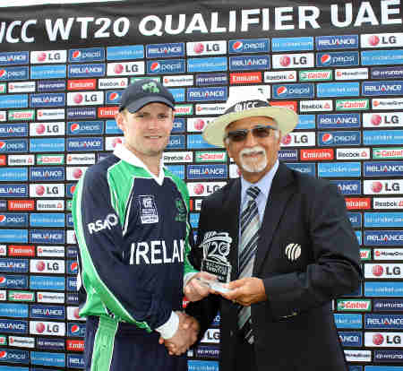 William Porterfield of Ireland receives the MOM award from ICC Match referee Dev Govindjee
