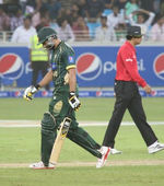 Shahid Afridi walking off after being dismissed