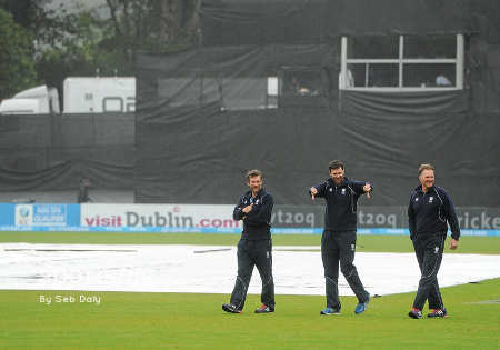 Groundsmen sharing a laugh as the rain ruined the final