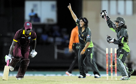 Rabiya Shah, wicketkeeper and Marina Iqbal run out Deandra Dottin