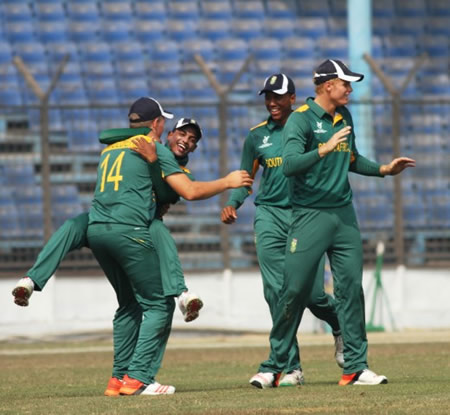 Wiann Mulder (left) and members of South Africa Under-19s celebrate a wicket during the warm-up match against West Indies Under-19s