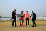 England captain flicks the coin as the West Indies captain looks on