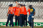 England celebrate after getting the wicket of Kaveen Bandara