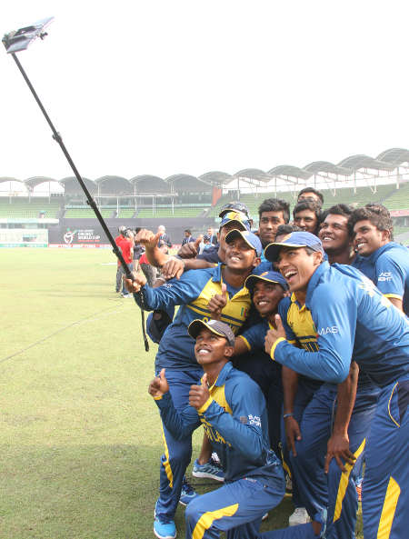 An ecstatic Sri Lanka take a selfie after beating England