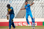 Avesh celebrates Avishka Fernando's wicket