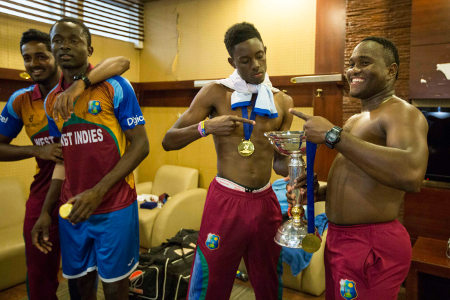 Under-19 Champions celebrate in the dressing room