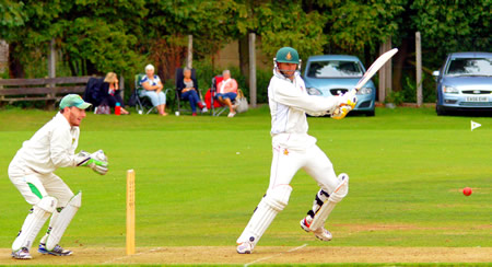 Stephan Marillier cuts as Sam Groves keeps wicket