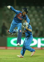 Sushma Verma of India celebrates the run out of Sana Mir