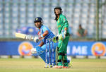 Shikha Pandey of India hits out with Sidra Nawaz of Pakistan looking on