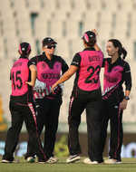 Erin Bermingham of New Zealand(R) celebrates a wicket with team mates