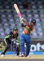 Chamari Atapattu Captain of Sri Lanka hits out with Alyssa Healy of Australia looking on during the Women's ICC World Twenty20