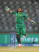Sidra Nawaz of Pakistan celebrates a catch to dismiss Sanjida Islam of Bangladesh
