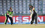 Ellyse Perry of Australia bats with Mary Waldron of Ireland looking on