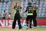 Megan Schutt of Australia celebrates the wicket of Clare Shillington of Ireland with team mates