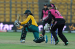 Marizanne Kapp of South Africa sweeps one to fine leg