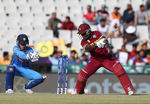 Deandra Dottin of the West Indies hits out with Sushma Verma of India looking on