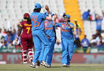 Anuja Patil of India celebrates the wicket of Kyshona Knight of the West Indies with team mates